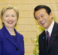 Down to business: U.S. Secretary of State Hillary Rodham Clinton and Prime Minister Taro Aso pose for a photo before their meeting at the prime minister's office Tuesday evening. | KYODO PHOTO