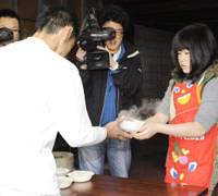 New reality: A temporary worker receives food Saturday at a makeshift employment center in Osaka set up to help people who have lost or are about to lose their jobs. | KYODO PHOTO