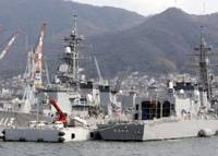Avast pirates!: The Maritime Self-Defense Force destroyers Sazanami (left) and Samidare are moored at the MSDF Kure base in Hiroshima Prefecture last month ahead of their anticipated dispatch off Somalia. | KYODO PHOTO