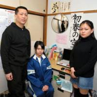Deadline pressure: Noriko Calderon, 13, poses at her home in Warabi, Saitama Prefecture, on Tuesday with her parents, Arlan and Sarah, who must decide whether to leave Japan with or without her by Monday. | YOSHIAKI MIURA PHOTO