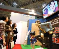 Live action: Visitors admire life-size mannequins of popular 'anime' animation characters Lupin the 3rd and Child Detective Conan during the Tokyo International Animation Fair 2009 at Tokyo Big Sight on Wednesday. | YOSHIAKI MIURA PHOTO