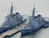 Counting down: Aegis destroyers Kongo (left) and Chokai, both equipped with antiballistic missile defense systems, are about to leave the Nagasaki Prefecture port of Sasebo on Friday morning and head for the Sea of Japan. | KYODO PHOTO