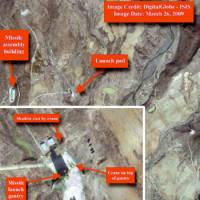 Eye in the sky: A satellite image taken Thursday by Digitalglobe shows the vehicle assembly building and launchpad for a North Korean missile facility at Musudan-Ri. The inset contains a magnified image of the launchpad. | KYODO PHOTO