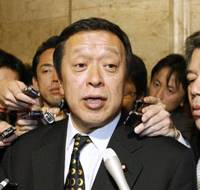 All systems go: Defense Minister Yasukazu Hamada faces reporters Friday in the Diet after the Cabinet gave the go-ahead to shoot down any part of a North Korean rocket that might fall toward Japanese territory. | KYODO PHOTO
