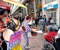 Drumming up interest: Banging drums and gongs, 'chindonya' street performers trumpet an event in the Jujo Ginza shopping arcade in Tokyo in 2007. | AP PHOTO