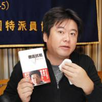 Calling it as he sees it: Takafumi Horie, founder and ex-CEO of Livedoor Co., speaks to reporters Thursday about his new book at the Foreign Correspondents' Club of Japan in Tokyo. | YOSHIAKI MIURA PHOTO