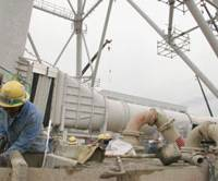 Second try: Workers prepare to restart the Kashiwazaki-Kariwa nuclear power plant in Niigata Prefecture following two years of earthquake repairs. It is the world's biggest nuclear power plant in terms of output. | KYODO PHOTO