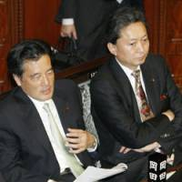Much to ponder: Katsuya Okada (left), deputy president of the DPJ and a likely candidate to seek the party's presidency, attends a plenary session of the Lower House on Tuesday with his likely prime opponent, Yukio Hatoyama. | KYODO PHOTO