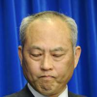 It's here: Health minister Yoichi Masuzoe announces Japan's first homegrown case of swine flu Saturday in Tokyo. | KYODO PHOTO