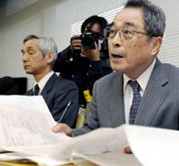 Searching for clues: Takaharu Miyanomae, principal of Kansai Okura High School, holds a news conference Sunday in Ibaraki, Osaka Prefecture. | KYODO PHOTO