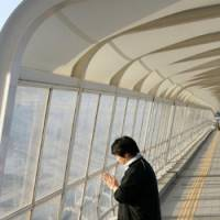 Looking for justice: Seiji Shimomura, 50, prays on the footbridge in Akashi, Hyogo Prefecture, where his 2-year-old son was killed in 2001 in a crush of people. | BLOOMBERG PHOTO