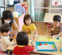 What swine flu?: Children play at a nursery school in Ashiya, Hyogo Prefecture, Saturday morning that reopened after the government relaxed restrictions on areas hit by swine flu. | KYODO PHOTO