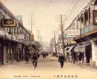 In the old days: This picture postcard shows a street in Yokohama's Chinatown around 1920, including signs for a piano maker and a Chinese restaurant. | COURTESY OF YOKOHAMA ARCHIVES OF HISTORY