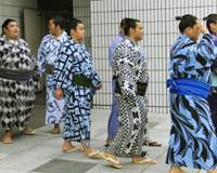 Antidrug drive: Sumo wrestlers leave the clinic at the Ryogoku Kokugikan in Tokyo after submitting urine samples for drug tests Monday. | KYODO PHOTO