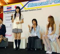 Cutesypoo: Entertainer Shizuka Fujioka (standing), known for her high school uniform outfits, dispenses fashion advice at a Japan Festival in Bangkok in March. | KYODO PHOTO