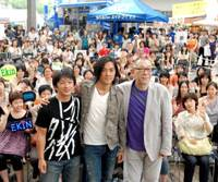 Celebrity boost: Hong Kong movie star Ekin Cheng (center), flanked by Kenji Tanigaki (left) and Yoichi Sai, two of the Japanese involved in his new movie 'Kamui Gaiden,' take the stage Saturday for Hong Kong tourism week at Roppongi Hills in Tokyo. The event ends Sunday. | YOSHIAKI MIURA PHOTO