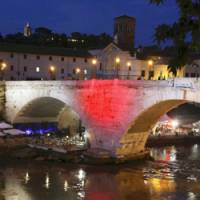 When in, where?: A bridge over the Tiber River in Rome sports red like Japan's Hinomaru national flag during the Japan-organized Japanitaly cultural event Tuesday. | KYODO PHOTO