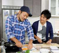 Food for thought: Chef and author Kentaro (left) and pop music star Taichi Kokubun tape their TV Tokyo cooking show in April. | KYODO PHOTO