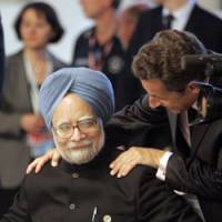 You scratch my back: Indian Prime Minister Manmohan Singh and French President Nicolas Sarkozy attend a round-table meeting at the G8 summit in L'Aquila, Italy, on Thursday. | AP PHOTO