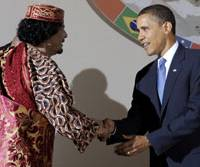 Greeting Gadhafi: Libyan leader Moammar Gadhafi shakes hands with U.S. President Barack Obama during a dinner Thursday at the G8 summit in L'Aquila, Italy, Gadhafi's first meeting with an American president. | AP PHOTO