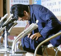 When words aren't enough: Nobuteru Ishihara, a Lower House member and chief of the Liberal Democratic Party's Tokyo chapter, bows in front of reporters at party headquarters Sunday following the LDP's crushing defeat in the Tokyo Metropolitan Assembly election. | KYODO PHOTO