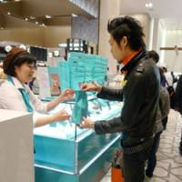 They're for my mom: A young man buys cakes at the Tokyo branch of the Daimaru department store chain on April 6. | KYODO PHOTO