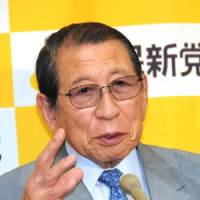 One issue at stake: Tamisuke Watanuki, president of Kokumin Shinto (People's New Party), is interviewed Wednesday at the party's headquarters in Tokyo. | SATOKO KAWASAKI PHOTO