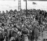 Home sweet home: Japanese imprisoned in Soviet labor camps after World War II arrive in Maizuru, Kyoto Prefecture, in December 1946 on the first ship to return from Siberia. | KYODO PHOTO