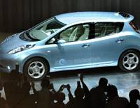 Star attraction: Nissan Motor Co.'s new electric vehicle, the Leaf, draws the scrutiny of photographers Sunday at the company's headquarters in Yokohama. | KYODO PHOTO