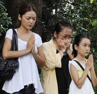 Sixty-four years on: Three women pray on Saturday at Chidorigafuchi National Cemetery, where the remains of unknown soldiers and civilians who died overseas during the war are buried. | KYODO PHOTO