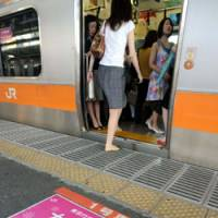 Safe haven: Passengers board a female-only car on the JR Chuo Line in Shinjuku Ward, Tokyo. | SATOKO KAWASAKI PHOTO