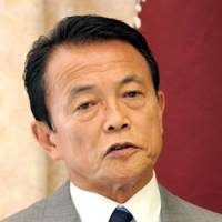 Down in polls, Aso says only LDP can provide security