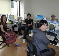 Reality check: Employees at Realthing, a company that produces animation and computer graphics, take a break in their office in Shibuya Ward, Tokyo, on Aug. 14. | KYODO PHOTO