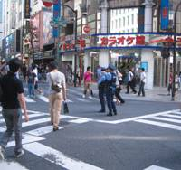 Make our day: Police patrol in Tokyo's bustling Shinjuku Ward on Aug. 16. | MINORU MATSUTANI