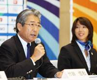 In the running: Japanese Olympic Committee President Tsunekazu Takeda addresses reporters with JOC Director Mikako Kotani. | KYODO PHOTO