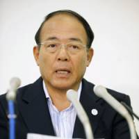 Kitchen closed: Pepper Food President Kunio Ichinose faces reporters Saturday in Sumida Ward, Tokyo. | KYODO PHOTO