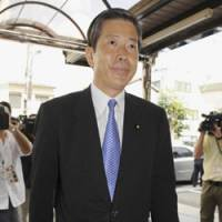 Changing of the guard: New Komeito's policy chief Natsuo Yamaguchi enters the party's headquarters in Tokyo on Monday. | KYODO PHOTO