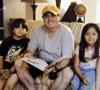 Custody battle: Christopher Savoie is shown with his children, Issac and Rebecca, in Franklin, Tenn., in an undated photo released by the Williamson County Court Clerk and Master's Office. | AP PHOTO
