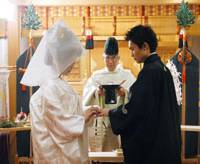 Goin' to the chapel: A couple in traditional kimono hold a mock wedding at a hotel in this undated photo. | KYODO PHOTO