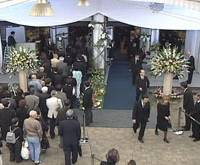 Growth industry: People gather at a funeral ceremony arranged by San Holdings Inc. | BLOOMBERG
