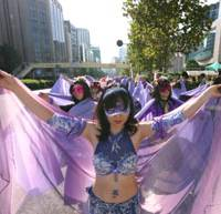 Lifting the veil: Victims of domestic violence march through Tokyo's Omotesando district on Nov. 1. | DAVID MCNEILL