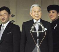 All in the family: Emperor Akihito, Crown Prince Naruhito and Crown Princess Masako greet the public during an event to celebrate the Emperor's birthday last Dec. 23 at the Imperial Palace. | KYODO PHOTO