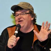 Citadel of capitalism: Movie director Michael Moore holds a news conference Monday at the Tokyo Stock Exchange. | YOSHIAKI MIURA PHOTO