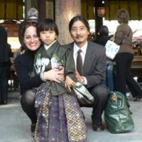 Family affair: Leza Lowitz, Shogo Oketani and their son, Yuto Dashiell Oketani, pose at Meiji Shrine in Tokyo's Shibuya Ward in November. | COURTESY OF LEZA LOWITZ