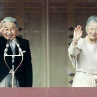Rising to the occasion: Emperor Akihito and Empress Michiko greet well-wishers Monday at the Imperial Palace. | KYODO PHOTO
