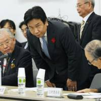 Power quest: Industry minister Yukio Edano greets members of a government panel tasked with forging the national energy policy on Nov. 3 in Tokyo. | KYODO PHOTO
