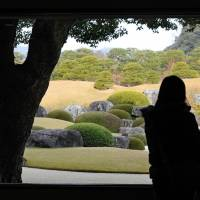 Visual art: Visitors admire the Japanese garden at the Adachi Museum of Art in Yasugi, Shimane Prefecture, on Tuesday. It was selected as the best Japanese garden by a U.S. magazine for the ninth consecutive year. | KYODO