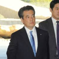 On business: Katsuya Okada, new deputy prime minister and state minister in charge of social security and tax reform, enters the Prime Minister's Official Residence on Friday. | KYODO