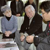 Personal touch: Sakie and Shigeru Yokota (left and center), whose daughter Megumi was whisked away to North Korea at age 13 in 1977, meet new abduction minister Jin Matsubara at their home in Kawasaki, on Saturday. | KYODO
