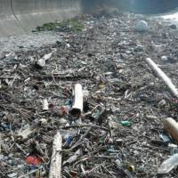 Washed up: Driftwood, plastic and other garbage are making a habitual mess of Nasa Beach on Toshi Island, Mie Prefecture.   MIE PREFECTURAL GOVERNMENT/CHUNICHI SHIMBUN